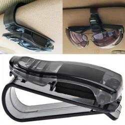 Glasögon- och parkeringsbiljetthållare för bilen.